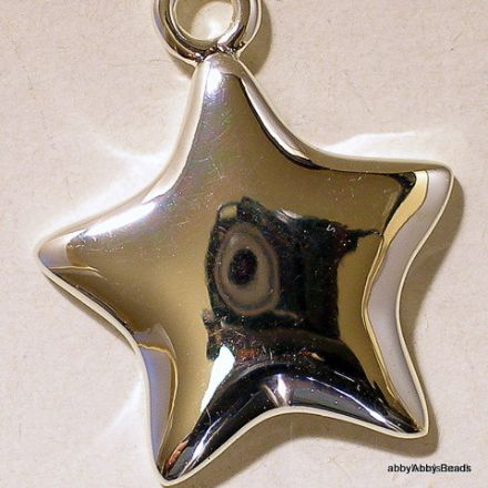 Star charm 25mm Silver plated with lobster clasp.